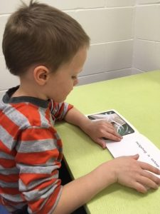 Boy Reading and Approved Book